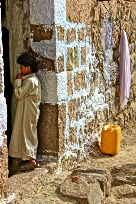 Boy getting water -- Bayt Baws, Yemen