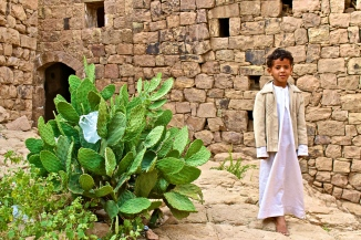 Boy and a cactus -- Bayt Baws, Yemen